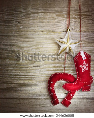 christmas background with cowboy western toys on wood texture - stock photo
