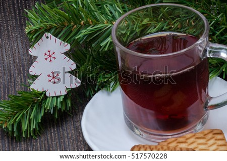 Christmas background with cup of tea and biscuits.