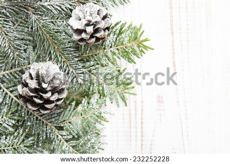 Christmas background with decoration with cones and twigs - stock photo