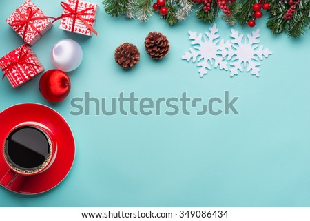 Christmas background with decorations and gift boxes on blue cyan background - stock photo