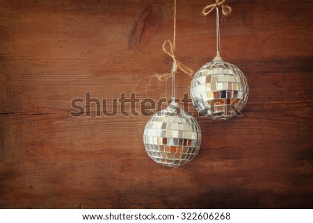 christmas background with decorations hanging on a rope over wooden background  - stock photo