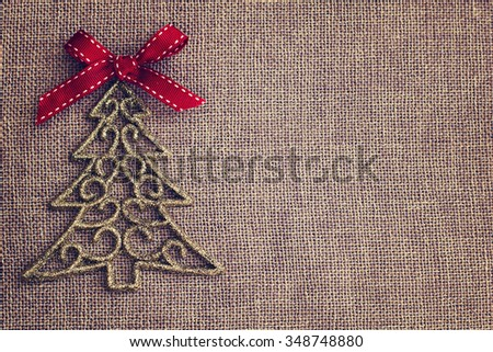 Christmas background with decorative tree and red bow - stock photo