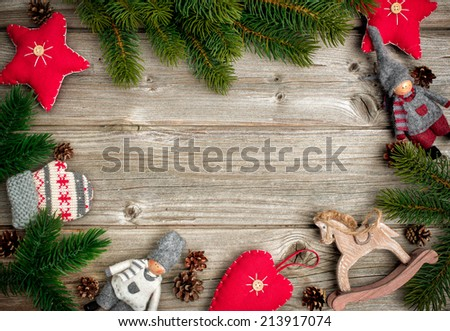 Christmas background with festive decoration and toys over wooden board - stock photo