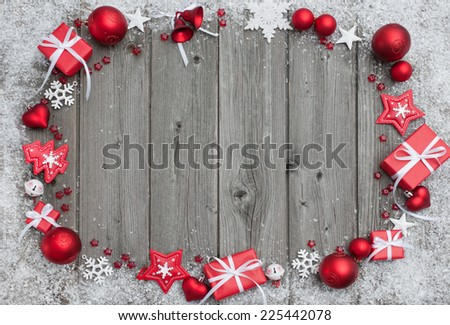 Christmas background with festive decoration over wooden board - stock photo