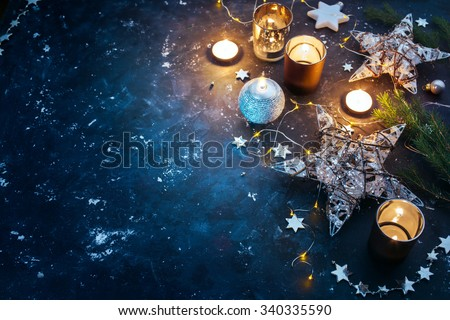 Christmas background with festive decoration, stars and candles. Christmas background with copyspace - stock photo