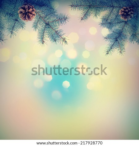 Christmas background with fir branch. Vintage colors - stock photo