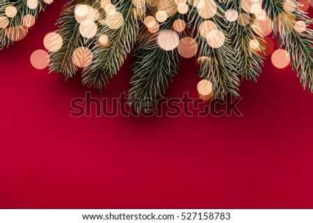 Christmas background with fir tree branches and bokeh blurred fairy lights