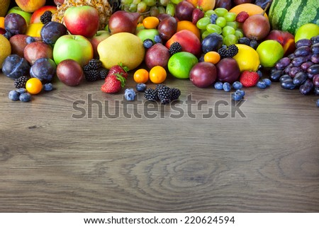 Christmas background with fresh fir-tree and  baubles on wood - horizontal - stock photo