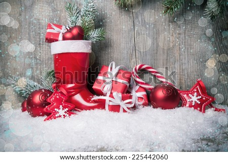 Christmas background with gift boxes over wooden board - stock photo