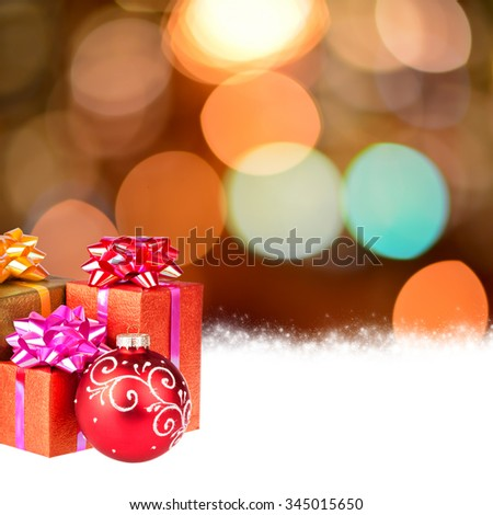 Christmas background with gifts, ball and bokeh lights