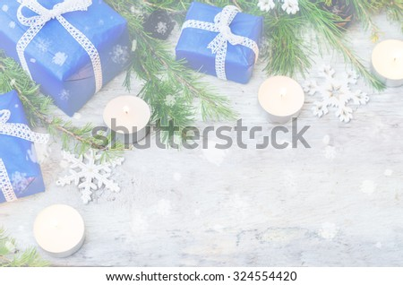 Christmas background with gifts, candels and fir tree on white background. toning. selective focus
