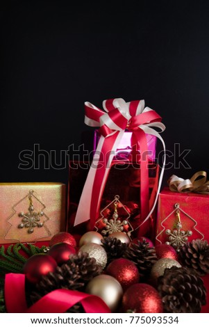 christmas background with gifts,pine, red and golden balls