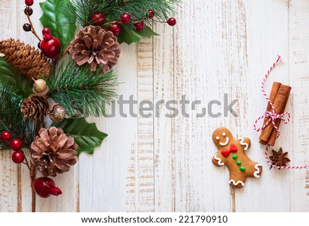Christmas background with gingerbread,fir  branches and spices on the old wooden board - stock photo