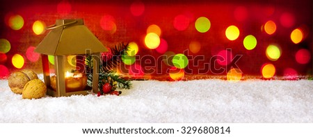 Christmas background with lantern and colorful lights.Golden lantern with candlelights for Christmas decoration.White snow. - stock photo