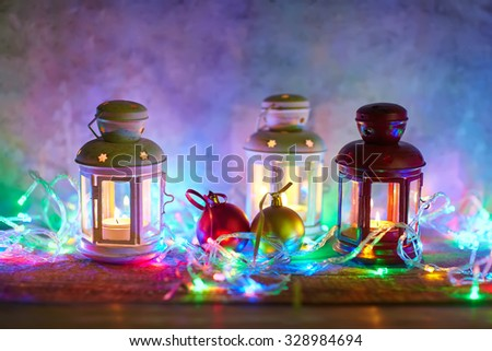 Christmas background with lanterns, baubles and garland - stock photo
