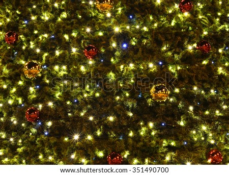 Christmas background with lights and bulbs - stock photo