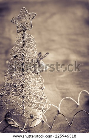 Christmas background with little tree and shin bell. Selective focus - stock photo