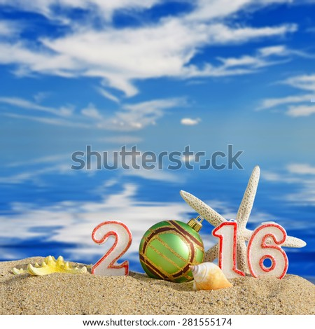 Christmas background with New year 2016 sign on a beach sand - stock photo