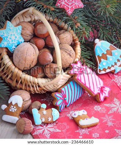 Christmas background with nuts and gingerbread - stock photo