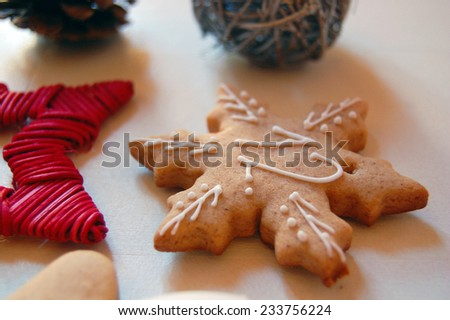 Christmas background with ornaments and gingerbread cookies on white wooden table  - stock photo