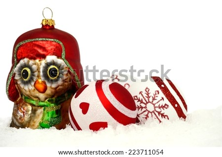 christmas background with owl and bauble in snow - stock photo