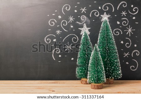 Christmas background with pine tree over chalkboard drawing - stock photo