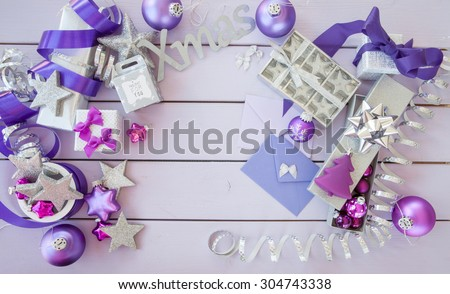 Christmas background with purple xmas ornaments and baubles - stock photo