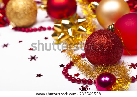 Christmas background with red and gold balls, stars and snowflakes, soft focus. - stock photo