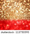 Christmas background with red and gold defocused lights - stock photo