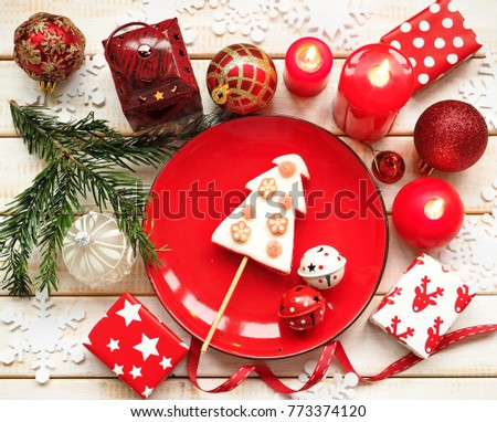 Christmas background with red candles, fir tree, Christmas balls and cookie
