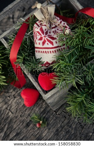 Christmas background with rustic ornaments and fir tree. Xmas vintage concept - stock photo