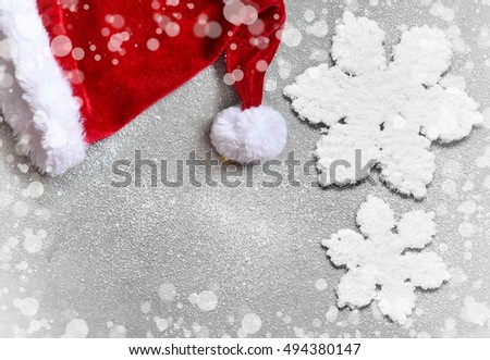 Christmas  background with Santa hat.  Merry Christmas. Snowflake