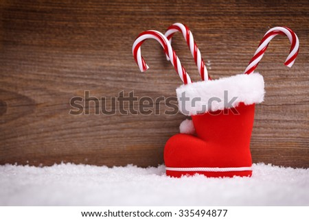 christmas background with santas boot and candy cane