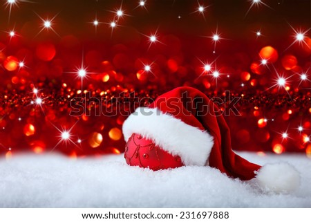 christmas background with santas hat and christmas ball in  snow - stock photo