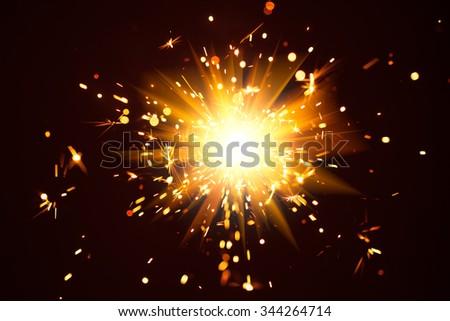 Christmas background with shiny sparkler light - stock photo