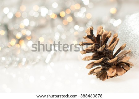 Christmas background with silver Christmas ball and cone. - stock photo