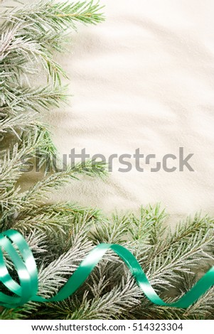 Christmas background with snow and firtree branch