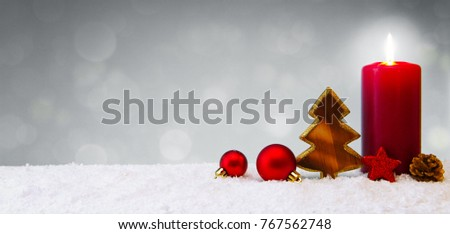 Christmas background with snow,candle and wood fir tree.