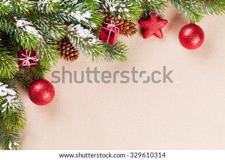 Christmas background with snow fir tree, bauble decor and copy space. Toned - stock photo