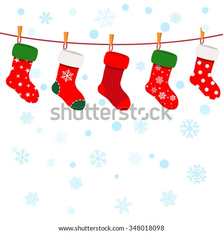 Christmas background with snowflakes and socks hanging on a rope
