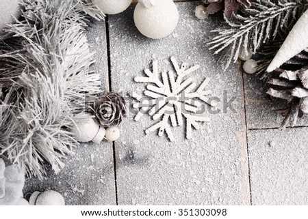 Christmas background with snowflakes, pine cones and balls, close-up/Christmas Snowy Background in Pastel Colors with a Snowflake