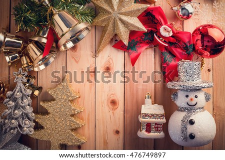 Christmas background with snowman on a rustic wooden board color tone