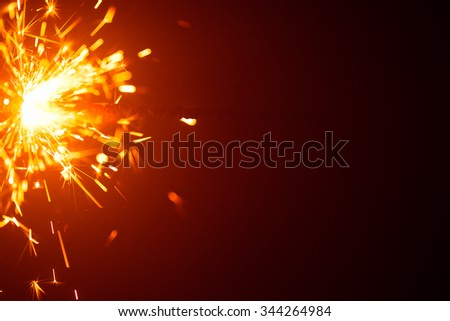Christmas background with sparkler light and copy-space - stock photo