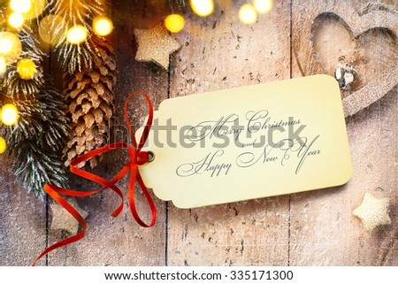 Christmas background with tree light and Christmas paper card - stock photo