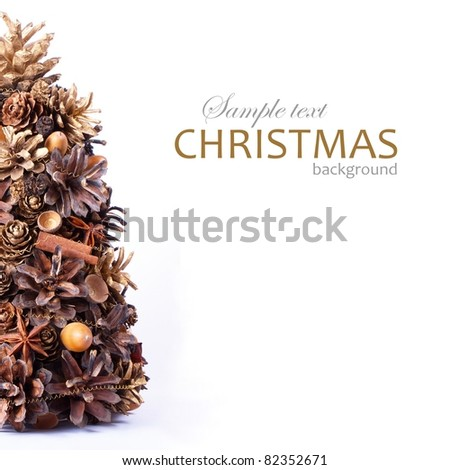 christmas background with tree made from natural cones, cinnamon, spices  and acorns with sample text