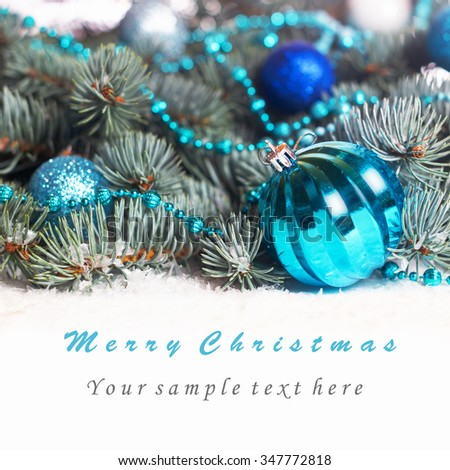 Christmas background with turquoise jewelry , balls , beads , blue spruce in the snow - stock photo