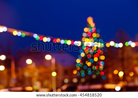 Christmas background with unfocused Christmas tree and snow by night - stock photo