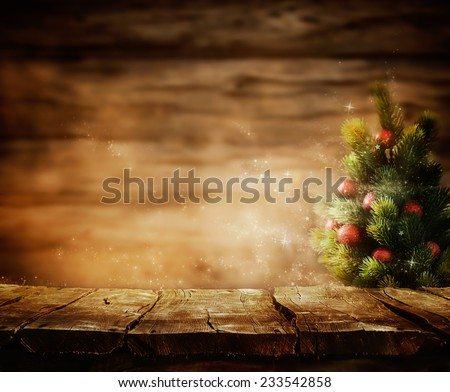Christmas background. Wooden table with Xmas tree. - stock photo