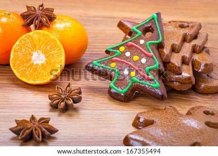 Christmas bakery with gingerbread, oranges and spices - stock photo
