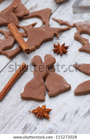 Christmas baking background with dough, spices and cookie cutters